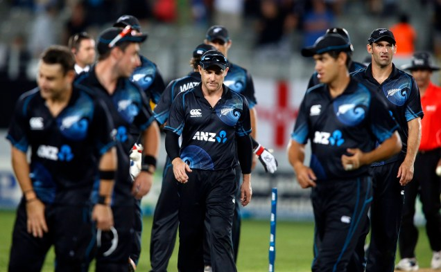 Captain McCullum of New Zealand walks off with his team after losing to England during the final cricket match of their one day international series at Eden Park